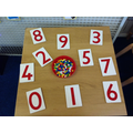 We carefully counted the pegs into the peg board.
