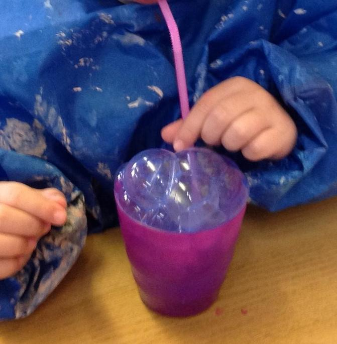 We blew down the straw to make bubbles.