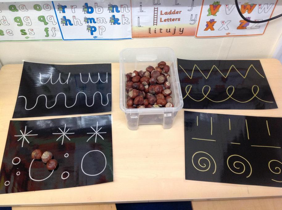 Following writing patterns using conkers,