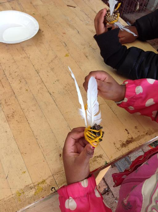 We used fir cones and feathers to make our own bees