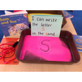 We had a go at writing the sounds - S in the sand.