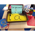 We had a go at writing the sounds - a in the sand.