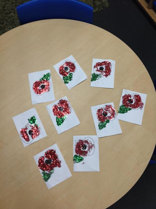 Making our glitter poppies for Remembrance Day