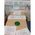 We coloured Shamrocks using green wax crayons.