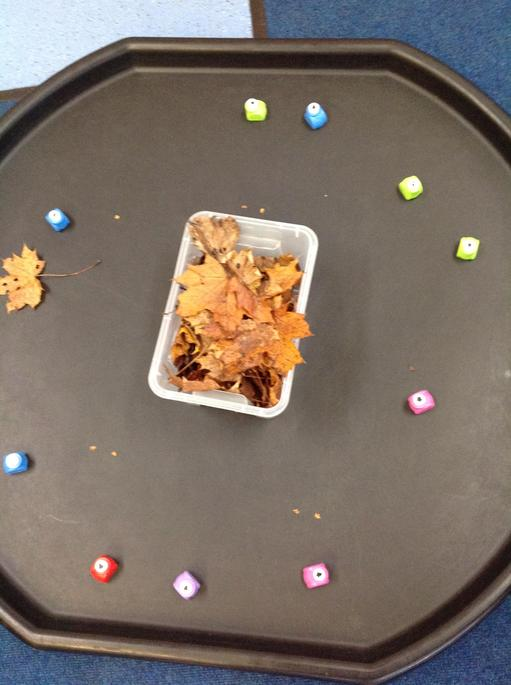 Making our own confetti - using leaves and hole punches.