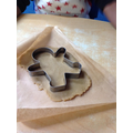 We used a gingerbread shape and pressed it into the dough.