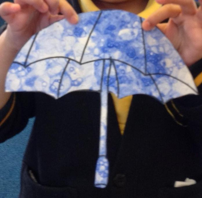 We decorated the umbrella with the bubbles.