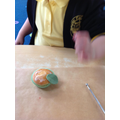 We made a poppy cupcake. We cut out a leaf shape.