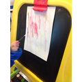 We used a paintbrush to create lines and patterns.