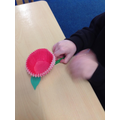 We used cupcake cases and Lollipop sticks.