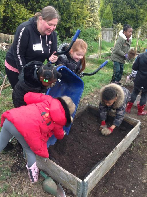 We put the soil in the new planters