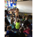 Mrs Earnshaw shares a story with Cherry class.
