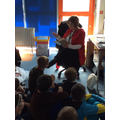 Mrs Alderson shares a story with Cedar class.