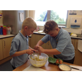Carefully cracking the egg into the mixture.
