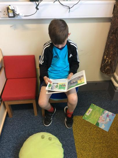 Enjoying a good book in our reading corner.