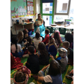 Mrs Holt shares a story with Sycamore class.