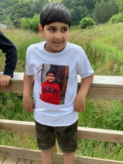 He has not one, but two different T-shirts with his photo on!