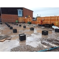Concrete pads for classrooms being poured .jpg