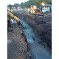 Strip foundation for classroom being poured .JPG