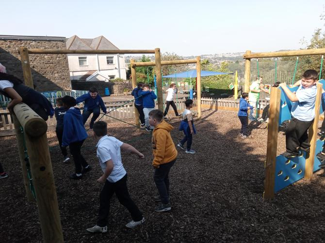 Here is Year 5 enjoying the new play equipment on the Foundation Phase play ground