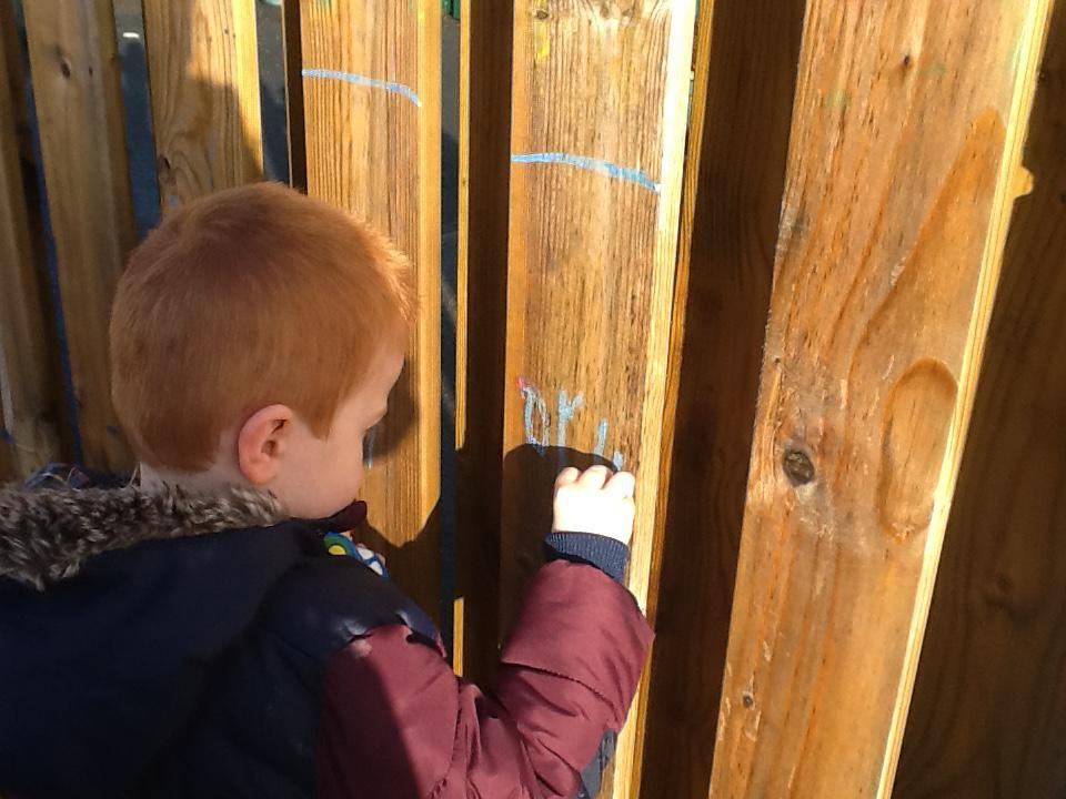 Marking the height on the fence.
