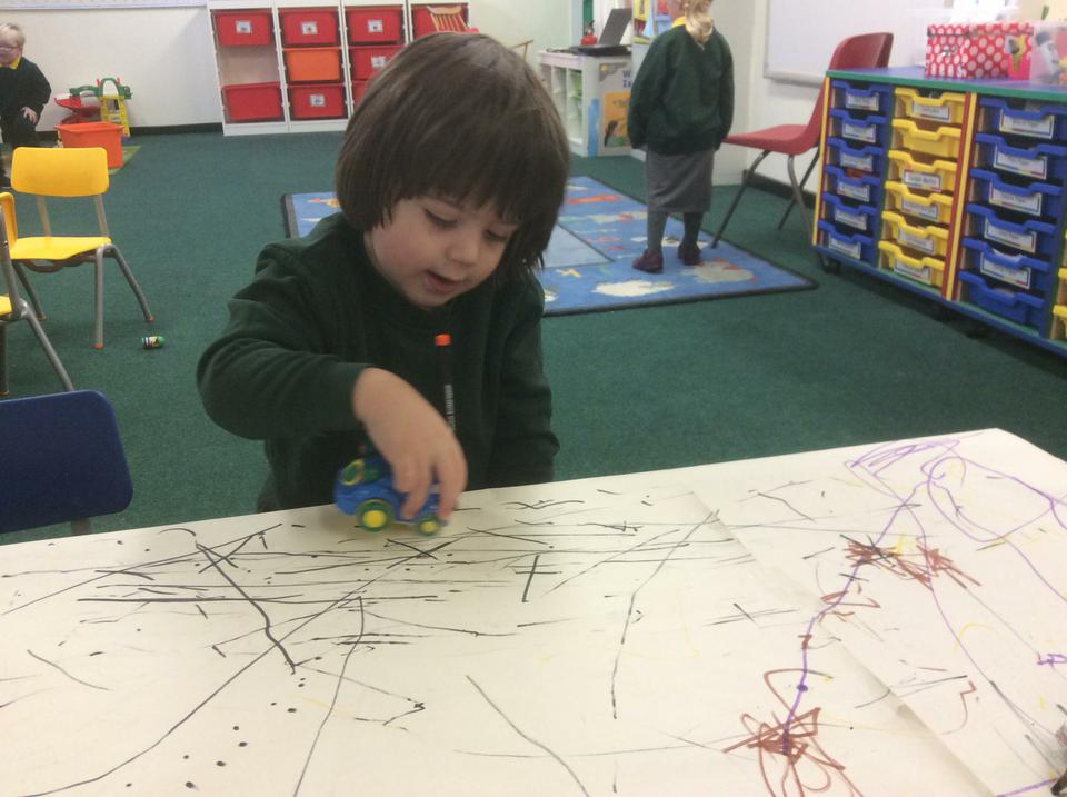 Mark making with cars .