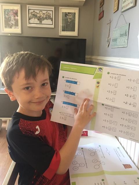 Travis working hard subtracting fractions