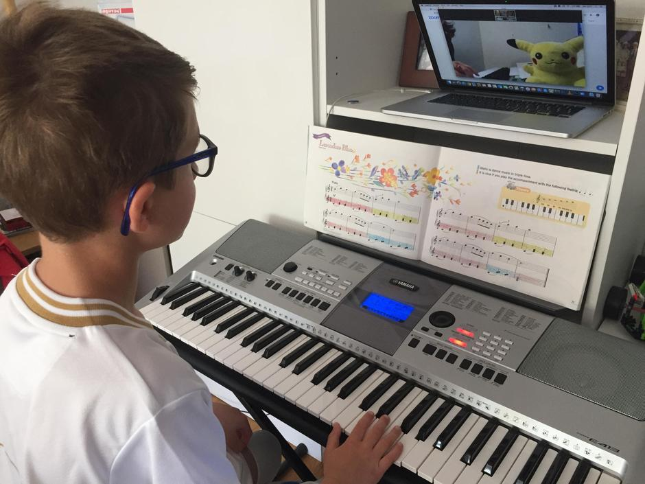 Arthur is busy practising his keyboard skills