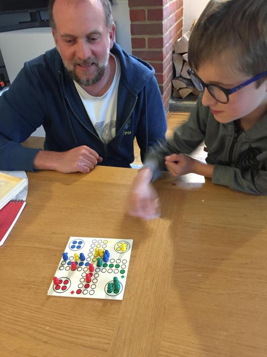 Arthur playing Ludo with his Dad