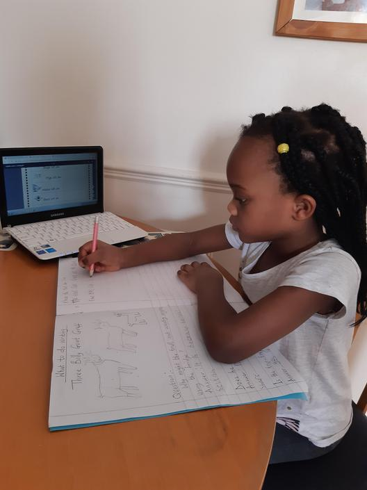 Semilore's working hard on her English work!