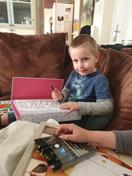 Alex busy with his home learning work!