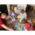 Austin playing monopoly with his nanny