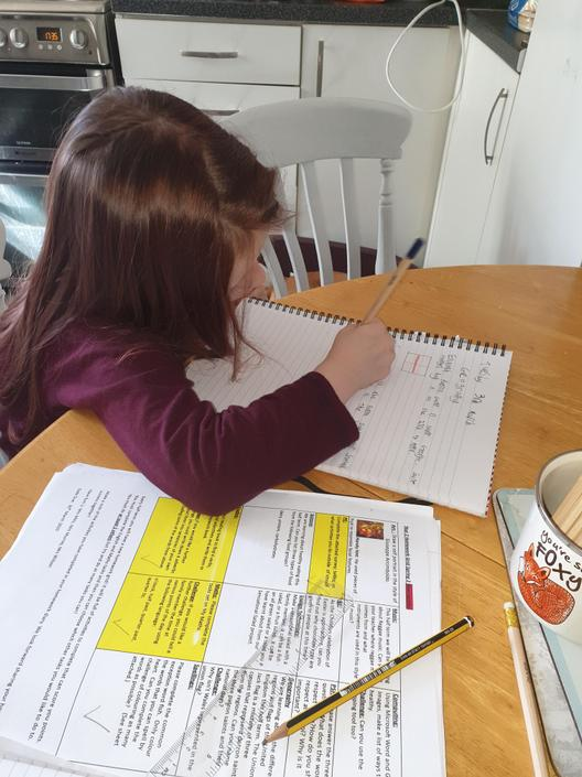 Ruby busy with her homework.
