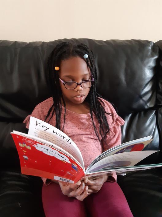 Nifemi is enjoying some reading.