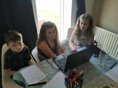 Izzie and Amelie concentraing hard on learning