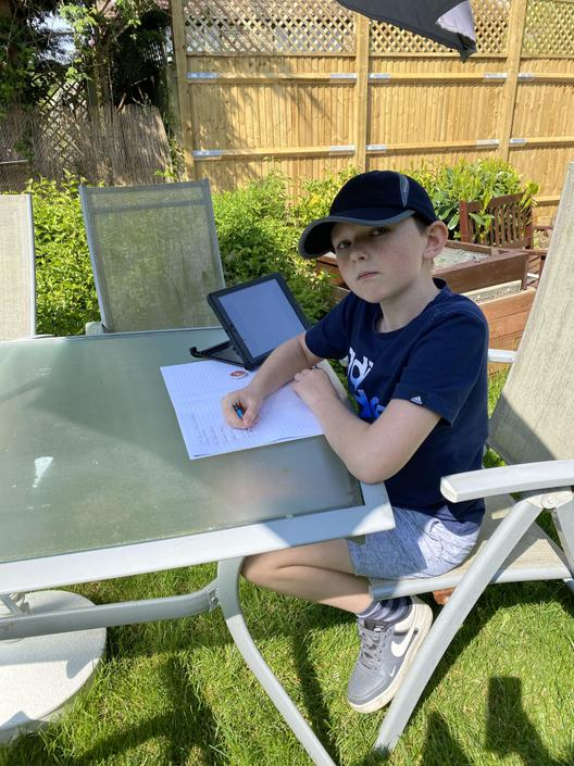 Scott's working hard with his home learning.