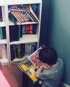 Travis enjoying reading his book!