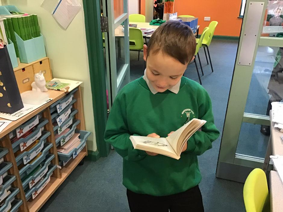 George entering the class reading his library book