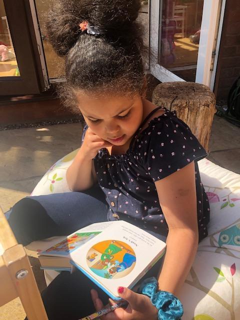 Lilah reading her Bible.