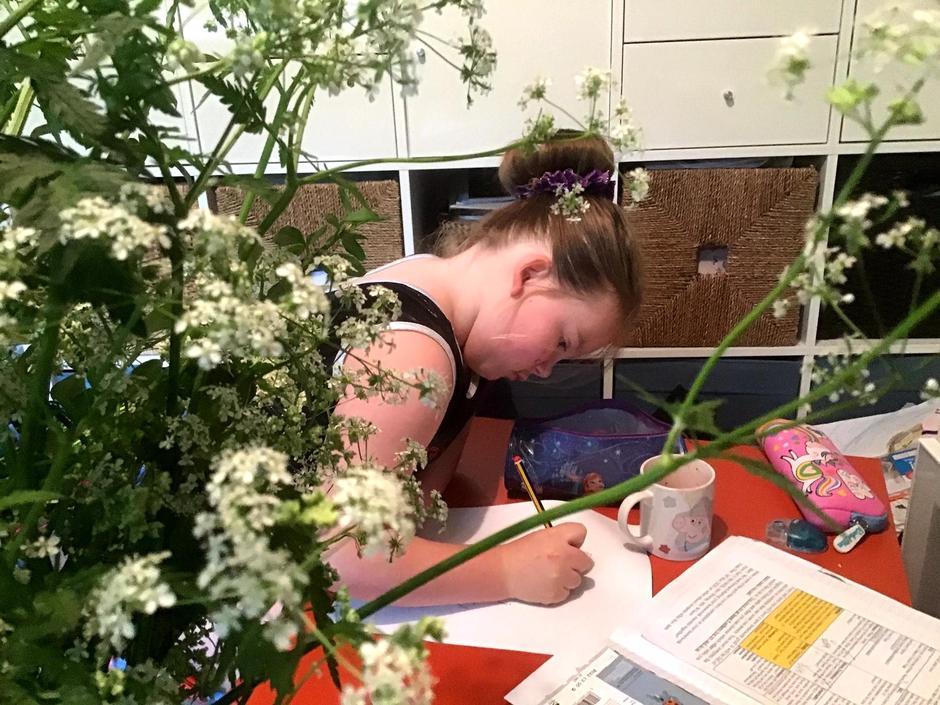 Chloe doing her art homework.
