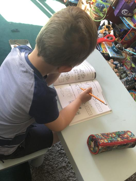 Archie's working hard on his maths!