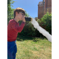 Blowing a bubble sock snake!