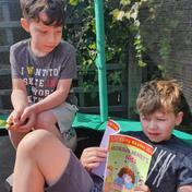 Max and Casey enjoying a book in the sun!