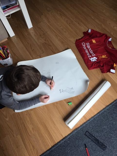 Travis has designed his own Liverpool football top