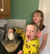 Charlotte and Jack are having fun baking