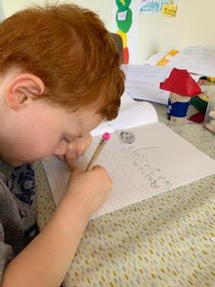 Austin trying hard with his writing.