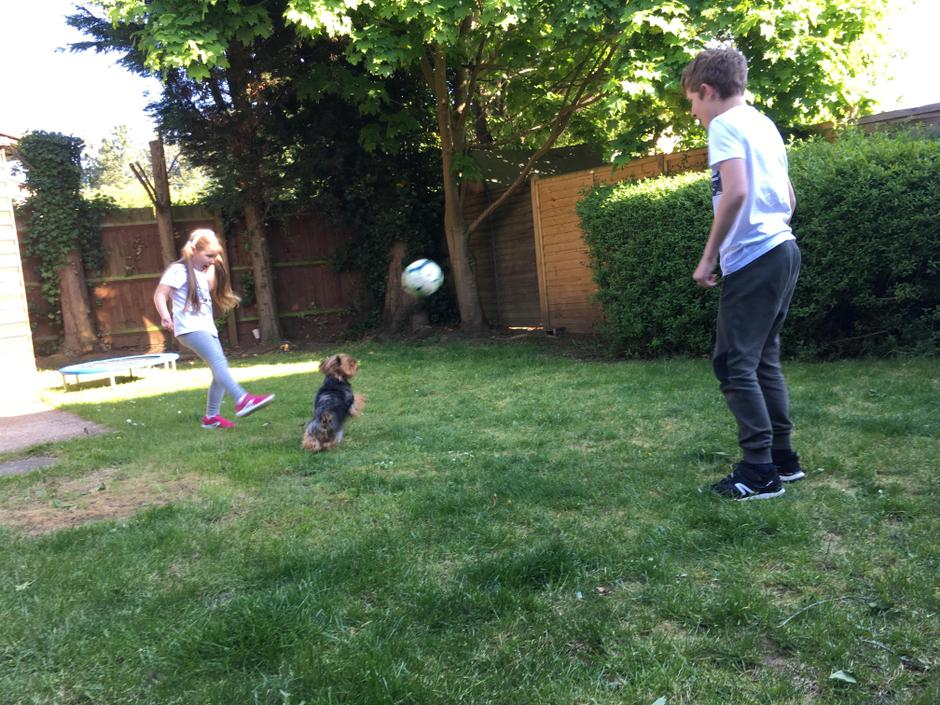 Pola playing football.
