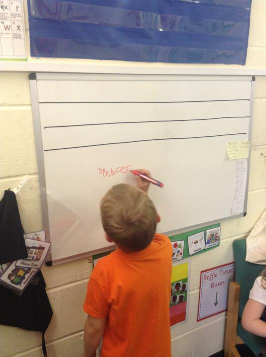 Spencer enjoyed writing his name on the board.