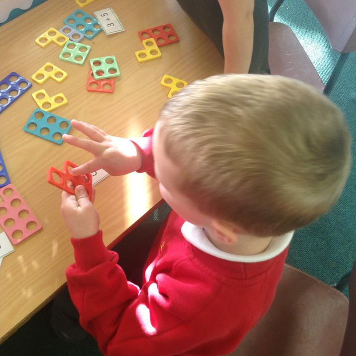 Using Numicon to solve addition number sentences.