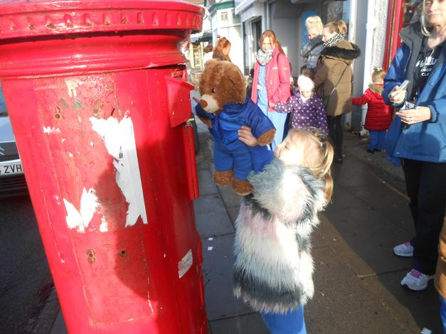 Posting his letter to Father Christmas.
